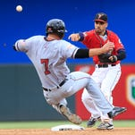 El Paso's Carlos Asuaje turns a double play after getting Mac Williamson out at second Tuesday at Southwest University Park.