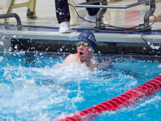 Avery Barley of Chambersburg looks back at the clock after completing the Class AAA boys 50 freestyle during the District 3 Swimming Championships on Friday. Barley's time of 21.97 put him in 13th place.