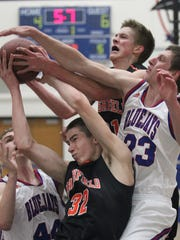 Merrill's Jake Anderson and Chaz Mootz battle for a