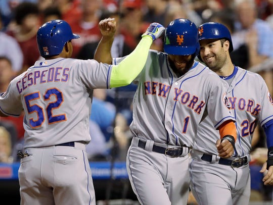 Mets' Yoenis Cespedes, left, Amed Rosario (1) and Neil