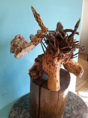 Fireclan totem sculpture by Neal Jones. Cholla root