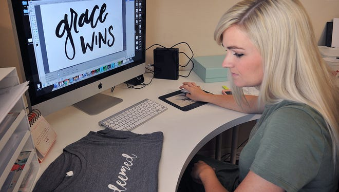 Nichole Kirk works on a graphic for a line of t-shirts she markets through her company, Dear Heart Designs. Kirk was named category winner for Expansion - GROW in 2016 for i.d.e.a.WF, a program at Midwestern State University's Dillard College of Business Administration, Munir Lalani Center for Entrepreneurship and Free Enterprise.
