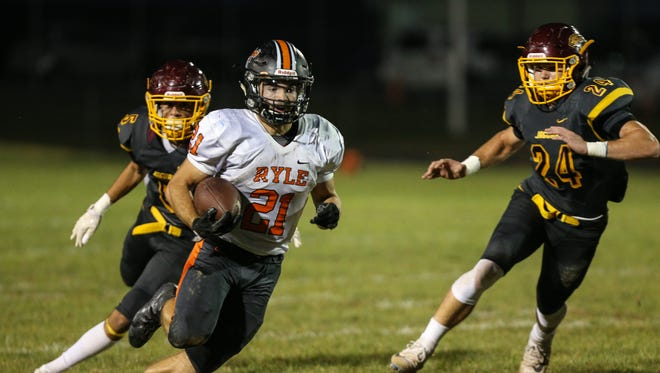 Ryle's Jacob Chisholm makes his turn and races to a 43-yard touchdown to give the Raiders an early 6-0 lead over Cooper during their game at Cooper, Friday, October 6, 2017.