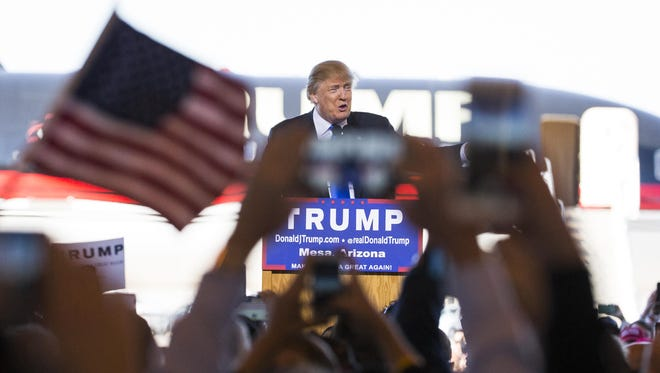 Republican presidential candidate Donald Trump addresses supporters inside a hangar at Phoenix-Mesa Gateway Airport on Wednesday.