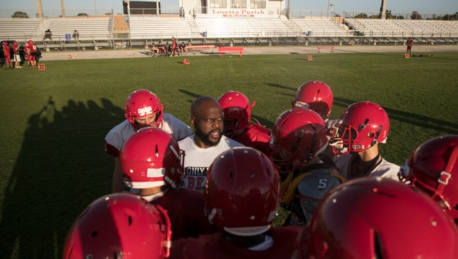 Earnest Graham coaches his North Fort Myers High School football team on Monday morning.