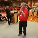 Jefferson teacher John Gable pauses after speaking to those gathered at an assembly where he was honored for being chosen Region 19 Secondary Teacher of the Year and a finalist for state Teacher of the Year. Principal Federico Rojas is at the microphone at left.