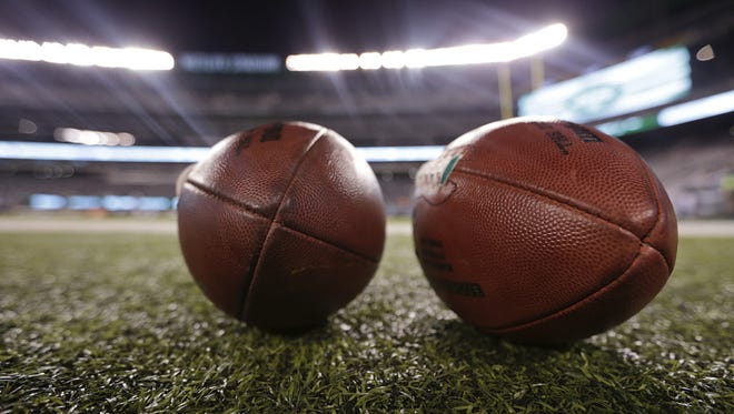 NFL footballs sit on the sidelines before an NFL football game between the New York Jets and the Chicago Bears, Monday, Sept. 22, 2014, in East Rutherford, N.J. (AP Photo/Julio Cortez)