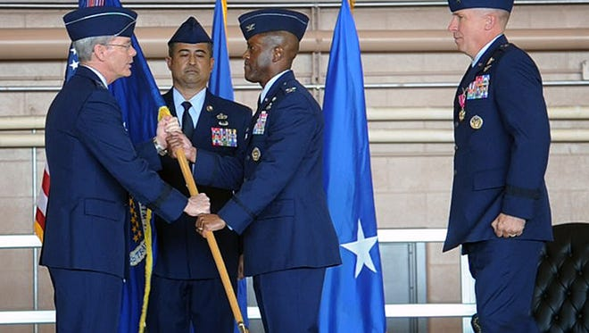 Maj. Gen. Robert LaBrutta, left, commander of the 2nd Air Force, transfers command of Sheppard Air Force Base from Brig. Gen. Patrick Doherty, right, to Col. Ronald Jolly Sr., center, Tuesday morning. To see video of the event, go to TimesRecordNews.com