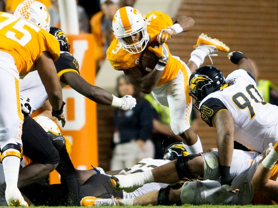 Tennessee running back Ty Chandler (3) leaps through the air during an game between Tennessee and Southern Miss at Neyland Stadium in Knoxville, Tennessee, on Saturday, Nov. 4, 2017.