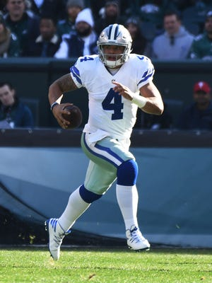 Dallas Cowboys quarterback Dak Prescott (4) scrambles in the first quarter against the Philadelphia Eagles at Lincoln Financial Field.