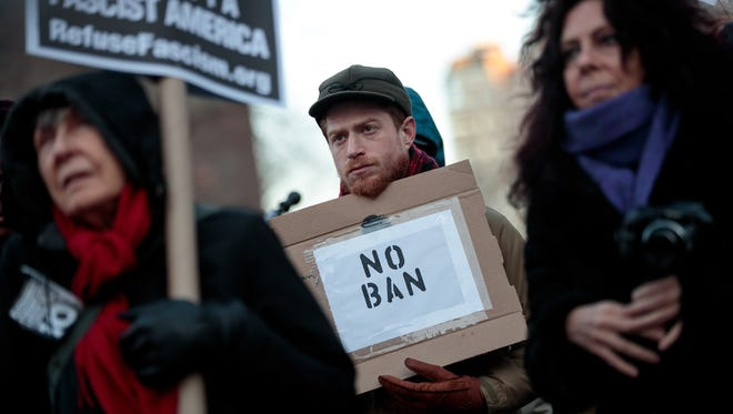 Demonstrators attend a small protest of President Trump's proposed travel ban on March 16, 2017 in New York City.