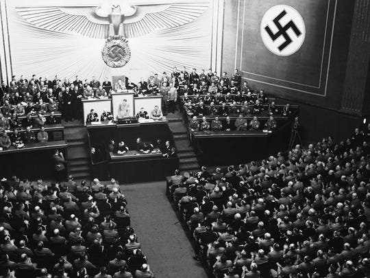 German Chancellor Adolf Hitler opened his long-awaited speech in the Krool Opera House with the reply to President Roosevelt for which the meeting had been called. He denounced the Anglo-German naval treaty as well as the German Polish treaty. General view of the scene inside the Kroll Opera House, during Hitler's speech in Berlin, on April 28, 1939. (AP Photo)