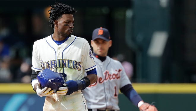 Dee Gordon, left, holds his helmet after he stole second base in the 11th inning of Sunday's game against the Tigers. Gordon later scored the game-winning run. The Mariners placed him on the 10-day disabled list on Tuesday.