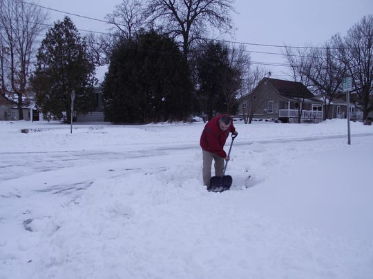 Joseph Towne, 37, Wisconsin Rapids, shovels eight inches of snow off his sidewalk Tuesday morning.