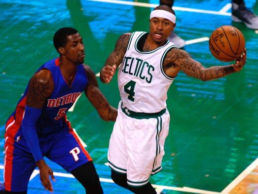 Celtics guard Isaiah Thomas holds onto the ball as