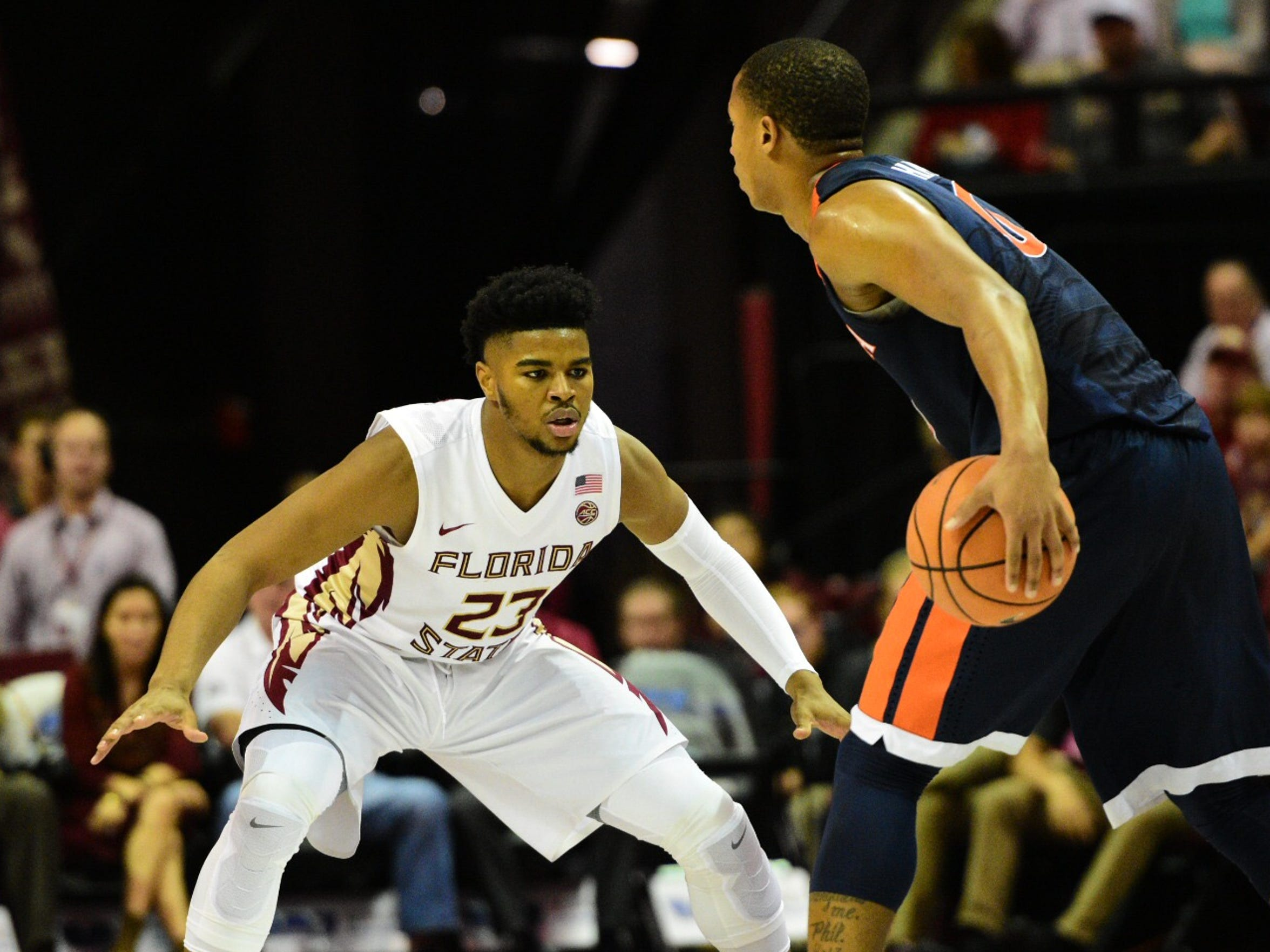 Freshman MJ Walker locks down on defense against the Virginia Cavaliers