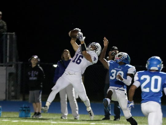 Elder's Kyle Trischler (16) catches a pass during the Panthers 35-34 win over Winton Woods, Friday, Oct. 13, 2017.