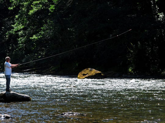 Monte Burke of Keizer casts into the Santiam River while fishing at Packsaddle County Park on Tuesday near Gates, Ore.