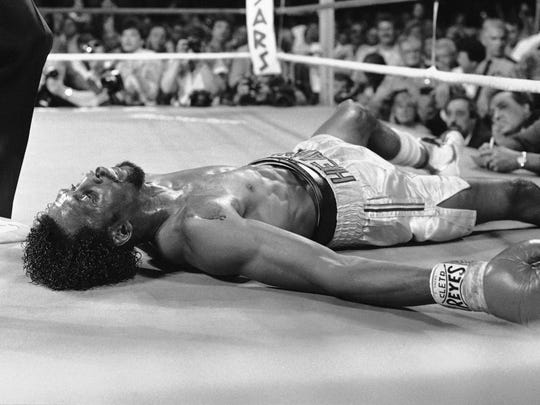 "Thomas ""Hitman"" Hearns lies on the mat after being knocked out by Marvelous Marvin Hagler in the third round of their undisputed world middleweight title fight April 15, 1985, in Las Vegas."