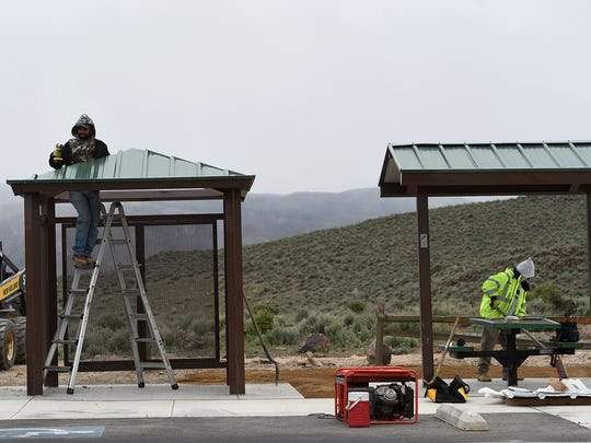 A work crew is seen building new shelters at Huffaker Hills Park in Reno on April 7, 2015.