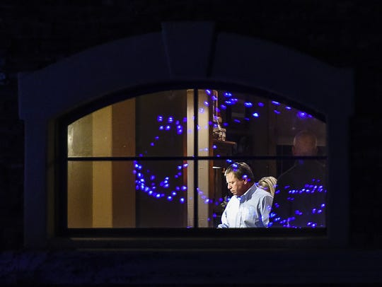 Jim McElwain is pictured through the kitchen window of his home near Fort Collins during prolonged negotiations Dec. 2, 2014, between Florida athletic director Jeremy Foley and CSU officials on a $7 million buyout package that allowed the football coach to leave CSU and become Florida's coach.