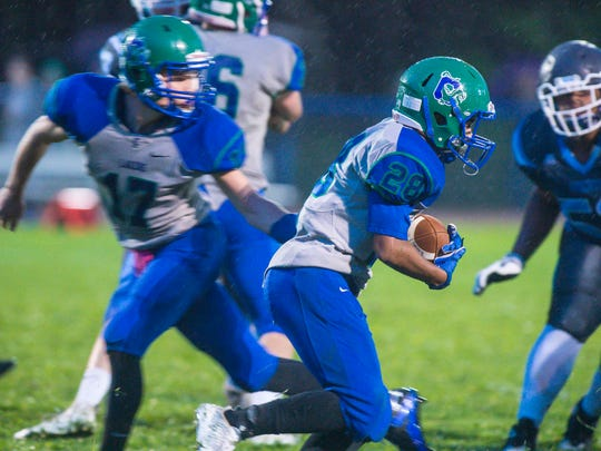 Colchester's Quentin Hoskins, right, takes a handoff from South Burlington's Zack Morin in Colchester on Friday, September 8, 2017.