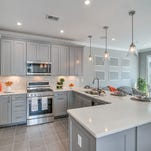 The kitchens at Cottrell Court, a new townhome community in Old Bridige, offer stainless-steel appliances, granite counters and 9-foot ceilings.