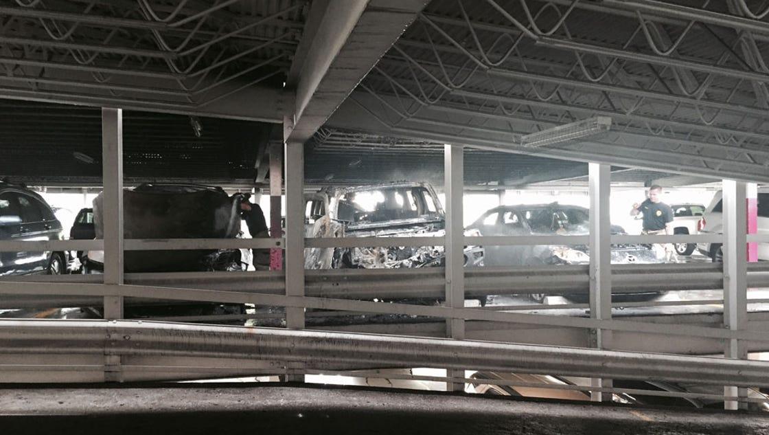 Three cars damaged in midtown parking garage fire