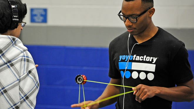Jacques Hatcher, a student at Lebanon High School, performs tricks with his yo-yo as other students wait for school to start on May 1.