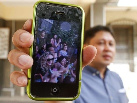 Filipino government worker Jasper De Guzman shows his