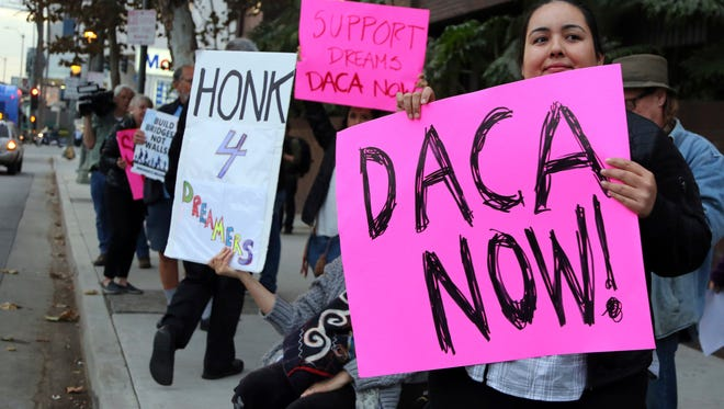 Demonstrators urge to protect the Deferred Action for Childhood Arrivals (DACA) program rally outside the office of Sen. Dianne Feinstein in Los Angeles.