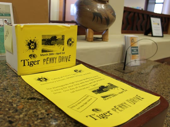 Employees of Otero Federal Credit Union can also donate their spare change towards the new tiger statue.