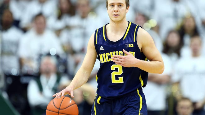 Michigan Wolverines guard Spike Albrecht dribbles against Michigan State in a 2015 game in East Lansing.