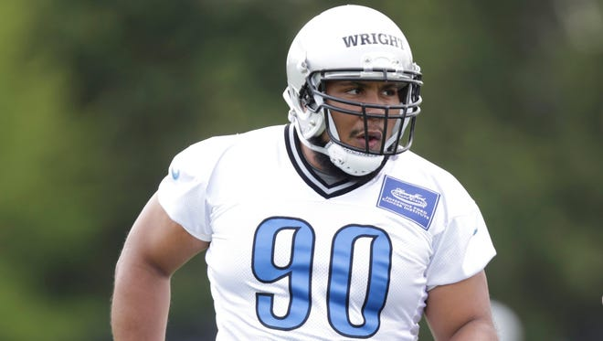 Detroit Lions defensive tackle Gabe Wright works out during rookie minicamp May 8, 2015 in Allen Park.