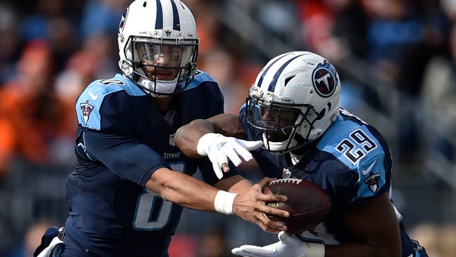 Titans quarterback Marcus Mariota (8) hands off to running back DeMarco Murray (29) at Nissan Stadium Sunday, Dec. 11, 2016, in Nashville, Tenn.