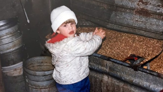 As a toddler, our daughter Stephanie, helped feed calves on my parents' dairy farm in Washington County.