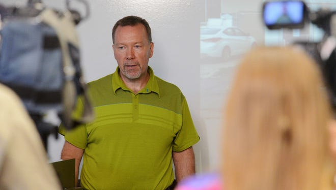 Steve Hildebrand, owner of Josiah's Coffeehouse & Cafe and a leader of a ballot initiative to cap the fees and interest rates on payday and title loans, speaks during a press conference Tuesday, July 28, 2015.