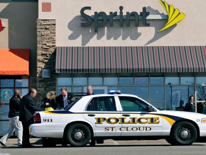 Police from Sartell with help from St. Cloud Police and the Stearns County Sheriff investigate a shooting at the Sprint store at 1733 Pinecone Road in Sartell.