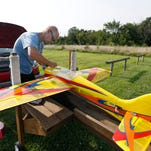 Wes Parker, president of the Springfield RC Club, prepares his plane at the club's airfield on Thursday, Aug. 6, 2015.
