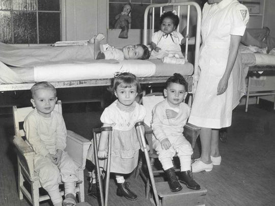 Young patients with a CSH nurse in 1948.