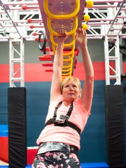"Wendy Oberholtzer, of North Lebanon Township,   goes across the monkey bars as she trains for ""American Ninja Warrior: on Tuesday, June 2016, at Paramount Sports Complex in South Londonderry Township. Oberholtzer said she decided to apply to be on the show to overcome a different sort of obstacle — being deaf."