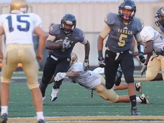 FILE – Darius Lee of Warren Central returns a kickoff against Cathedral, Aug. 30, 2013.