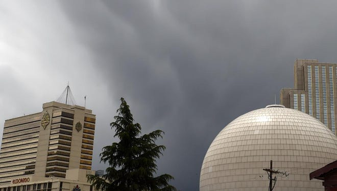 Clouds and rain wash over Reno on Wednesday, May 20, 2015.