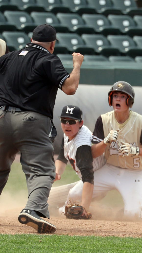 Trevor Montana of Clarkstown South is called out trying to stretch a double into a triple during the Section 1 Class AA baseball championship game at Palisades Credit Union Park in Pomona May 26, 2018. Clarkstown South defeated Mamaroneck 4-0.