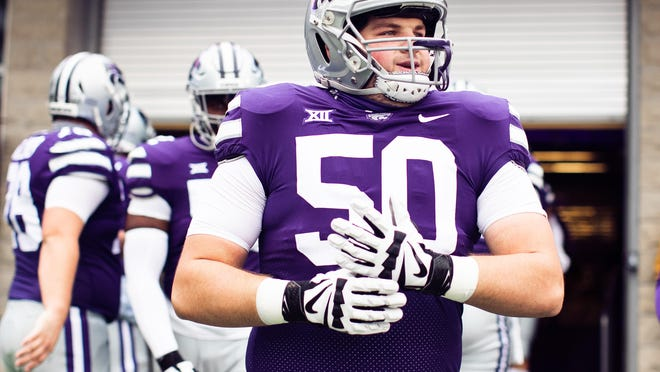 Cooper Beebe (50) and Kansas State's offensive line had to adjust last week after losing its starting guards to COVID-19 testing.