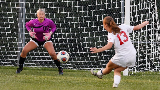 West Lafayette's Anneliese Givan blasts a shot past  Lafayette Jeff goalkeeper Kattey Pass for a goal at 34:58 in the second half Tuesday, September 5, 2017, in West Lafayette. The Red Devils pounded the Bronchos 6-1.