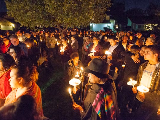 In this photo provided by The Bakersfield Californian, a crowd of about 150 people attend a candlelight vigil for Francisco Serna, 73, Tuesday, Dec. 13, 2016, in Bakersfield, Calif. Serna was shot and killed by a Bakersfield, Calif., police officer near his home early Monday morning. Police Chief Lyle Martin said Tuesday that the unarmed Serna refused to take his hand out of his pocket when he was shot by an officer who thought he had a gun. Serna's family said he suffers from dementia and he often took walks in the evening.