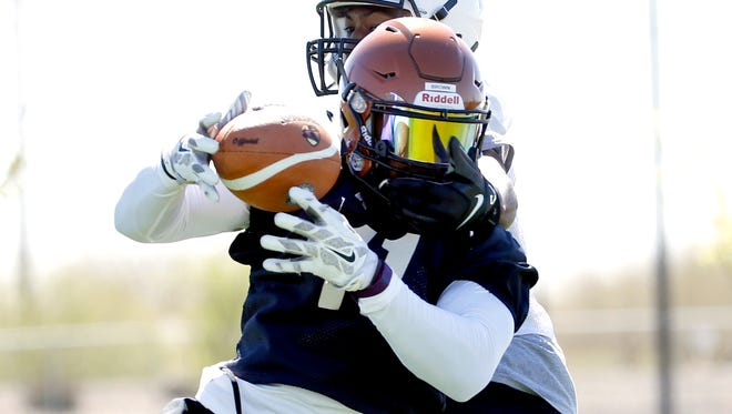 Arizona Rattlers defensive back Arkeith Brown intercepts the ball during training camp at Copper Sky Recreation Complex in Maricopa on March 10, 2016.