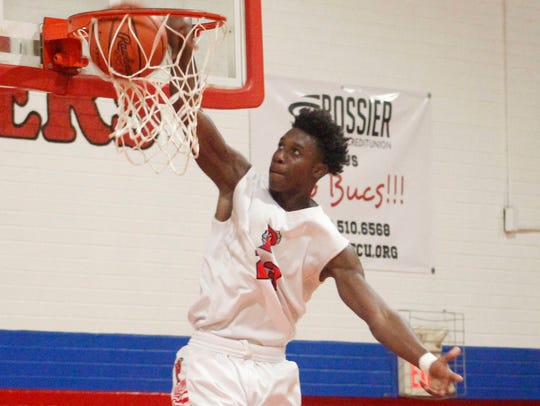 Terrace Marshall Jr.(23) dunks the ball after a fast