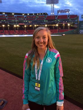 Shippensburg grad Neely Spence Gracey stands in Fenway Park following her ninth-place finish in the women's race at the 120th Boston Marathon on Monday.